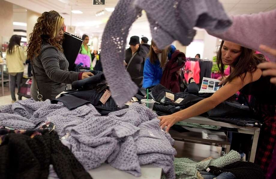 FILE -In this Friday, Nov. 23, 2012, file photo, shoppers rummage through a pile of sweaters on sale at a J.C. Penney store, in Las Vegas. U.S. consumer confidence rose this month to its highest level in almost five years, helped by a better outlook for hiring over the next six months. The Conference Board said Tuesday, Nov. 27, 2012, that its consumer confidence index rose to 73.7 in November from 73.1 in October. Both are the best readings since February 2008. (AP Photo/Julie Jacobson) / AP