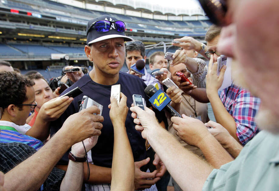 New York Yankees' Alex Rodriguez addresses a media swarm before a baseball game against the Toronto Blue Jays at Yankee Stadium, Wednesday, Aug. 21, 2013, in New York. (AP Photo/Kathy Willens) / AP