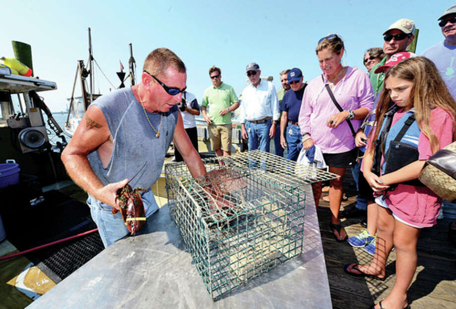 Hour photo / Erik TrautmannLobsterman Mike Kalaman instructs participants about lobstering during a tour of Norm Bloom and Sons Oysters and Clams facility Wednesday. The tour showed efforts to monitor and protect the water. / (C)2013, The Hour Newspapers, all rights reserved
