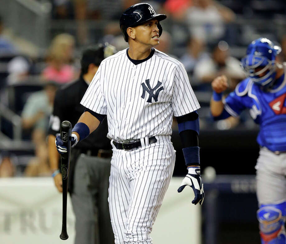 New York Yankees' Alex Rodriguez reacts after striking out in the fourth inning of the second baseball game of a doubleheader against the Toronto Blue Jays at Yankee Stadium, Tuesday, Aug. 20, 2013, in New York. (AP Photo/Kathy Willens) / AP
