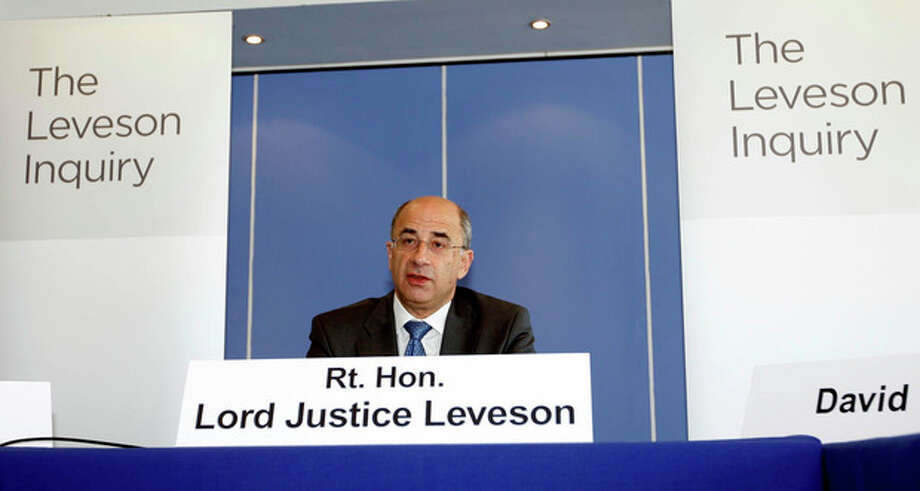 FILE - In this July 28, 2011 file photo, Lord Justice Brian Leveson speaks during the first formal session of his phone hacking inquiry in London. Leveson, who spent a year investigating the misdeeds of Britain's lively newspapers, is giving Britain's Prime Minister David Cameron an early look at his recommendations on Wednesday, Nov. 28, 2012 for the regulation of the press. (AP Photo/Sean Dempsey, Pool-File) / POOL PA
