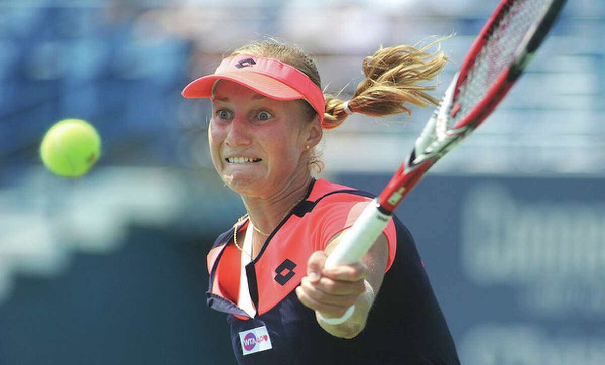 Hour photo/John Nash Ekaterina Makarova of Russia sees a nice high ball for a return smash during her second round match against top-seeded Sara Errani during Wednesday's action at the New Haven Open at Yale. Kakarova stunned Errani with a straight sets 7-5, 6-1 victory.
