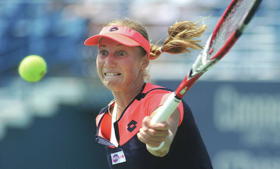Hour photo/John NashEkaterina Makarova of Russia sees a nice high ball for a return smash during her second round match against top-seeded Sara Errani during Wednesday's action at the New Haven Open at Yale. Kakarova stunned Errani with a straight sets 7-5, 6-1 victory.