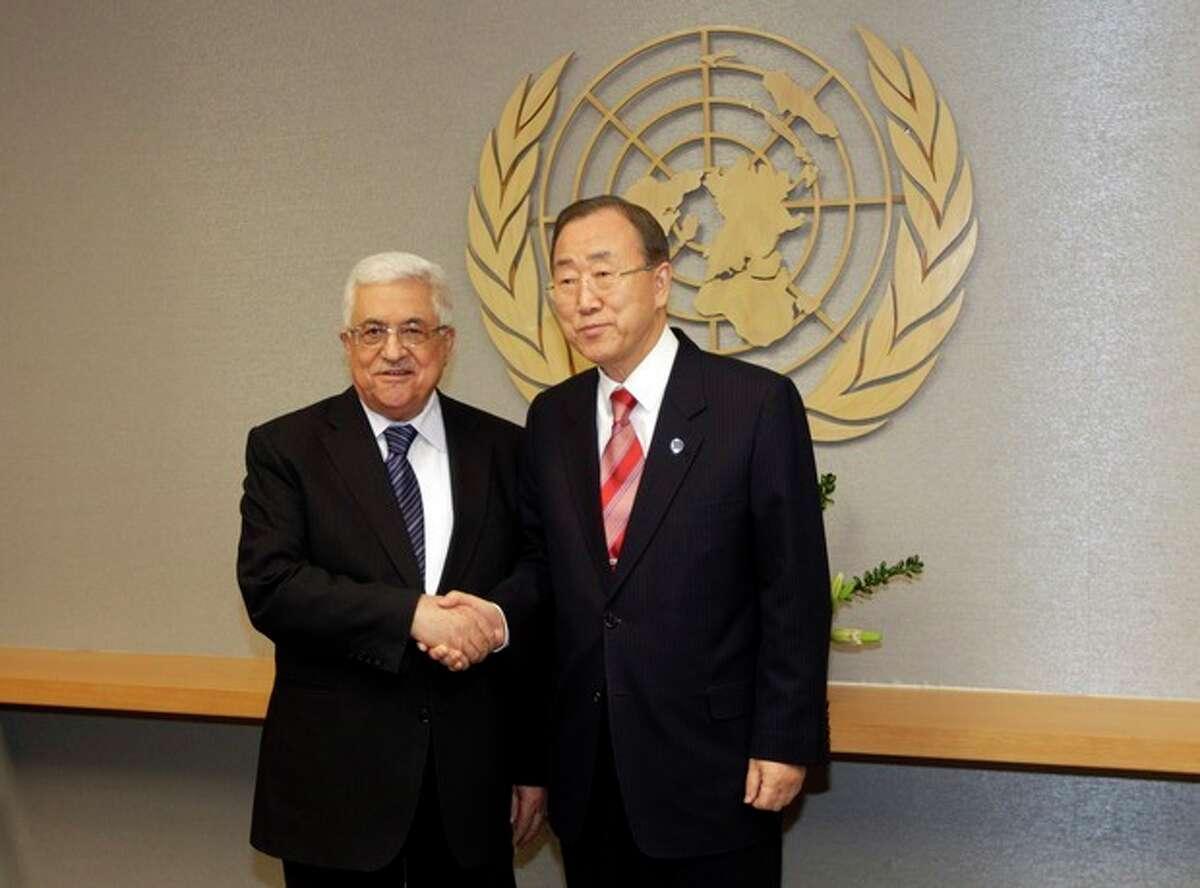 UN Secretary General Ban Ki-moon, right, shakes hands with Palestinian President Mahmoud Abbas at U.N. headquarters Wednesday, Nov. 28, 2012. (AP Photo/Frank Franklin II)