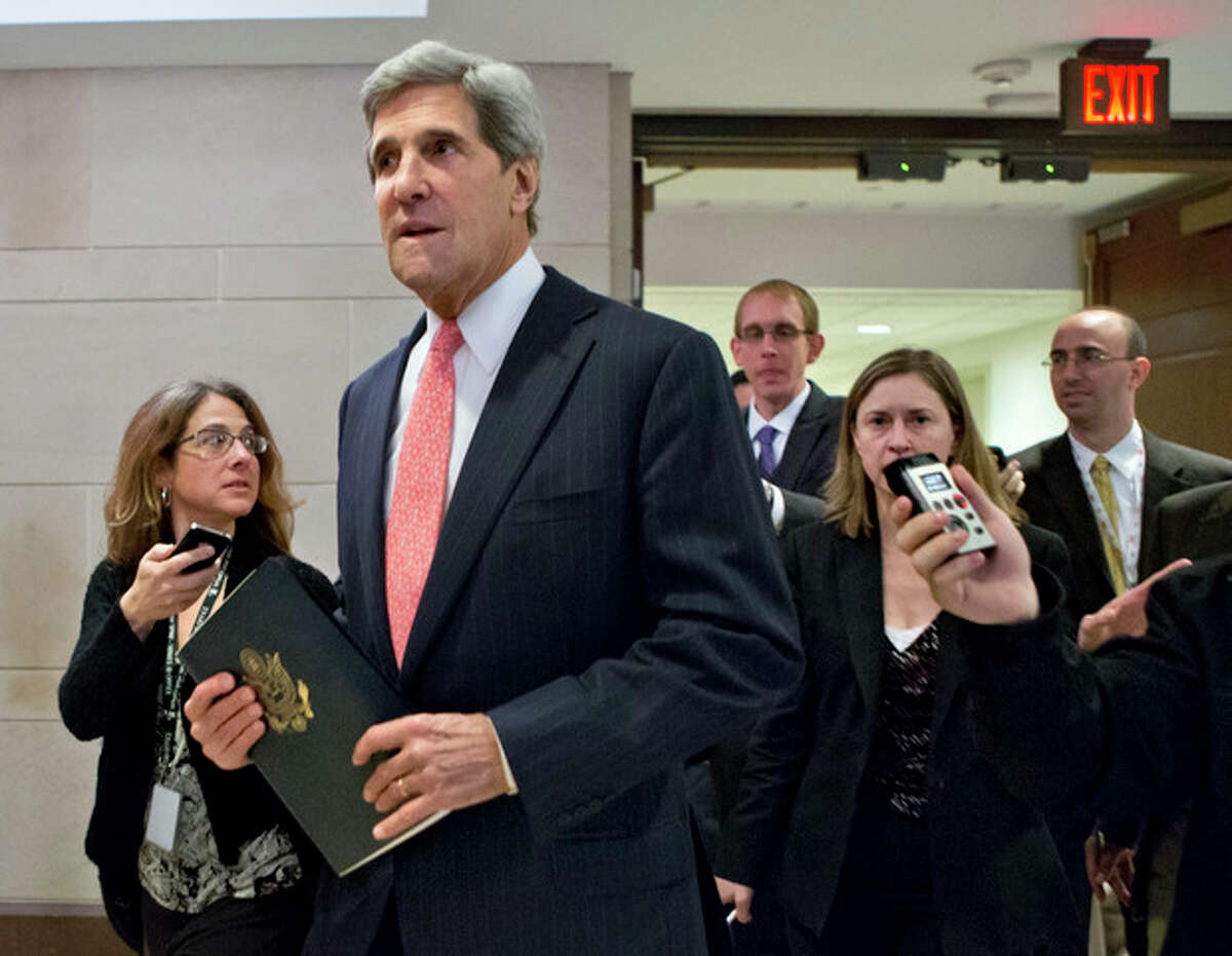 FILE - This Nov. 13, 2012 file photo shows Senate Foreign Relations Committee Chairman, Sen. .John Kerry, D-Mass. pursued by reporters as he arrives for a closed-door meetin on Capitol Hill in Washington. Kerry is angling for the nation?'s top diplomatic job by being diplomatic. He's asking supporters not to overtly lobby on his behalf, a strategy reflecting both his disdain for Washington?'s personnel politics and a recognition that if Obama taps Rice instead, Kerry will have to shepherd her difficult nomination through the Senate committee he runs. (AP Photo/J. Scott Applewhite, File)