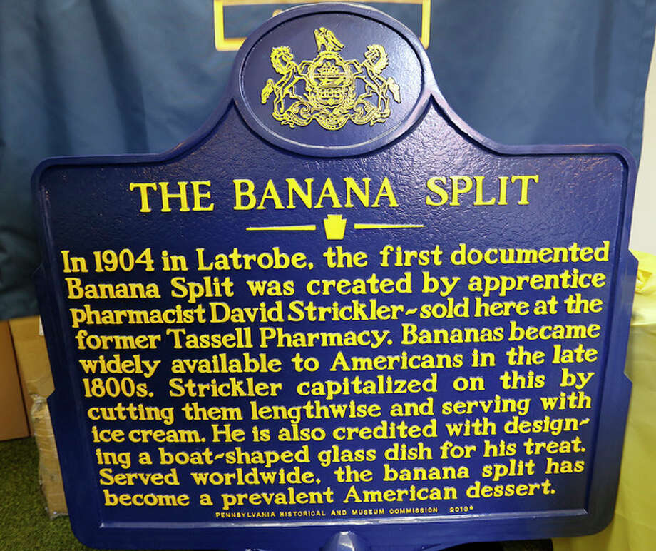 The Pennsylvania Historical and Museum Commission marker for the banana split is displayed at the municipal offices in Latrobe, Pa., Wednesday Aug. 21, 2013. A weekend of festivities are planned to surround the dedication of the marker that acknowledges apprentice pharmacist David E. Strickler for inventing the banana split there in 1904. (AP Photo/Keith Srakocic) / AP