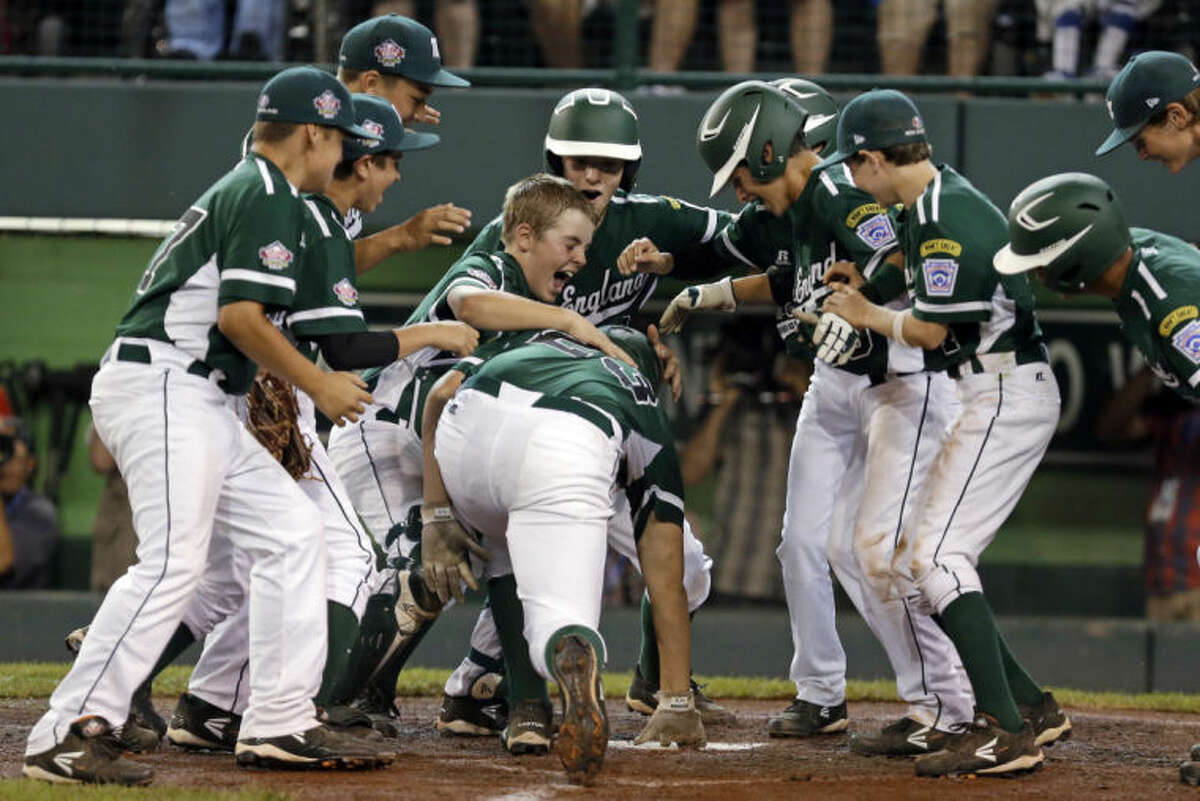 Westport, Conn.'s Matt Brown, center, bends to touch home plate after hitting a three-run home run off Chula Vista, Calif., pitcher Grant Holman in the fourth inning of a baseball game at the Little League World Series in South Williamsport, Pa., Wednesday, Aug. 21, 2013. Chula Vista won 6-3 in nine innings. (AP Photo/Gene J. Puskar)