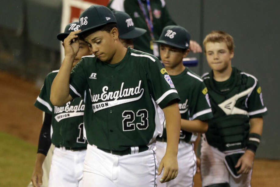 Westport, Conn.'s Matt Brown (23) and teammates line up to shake hands after a 6-3 loss to Chula Vista, Calif., in a baseball game at the Little League World Series tournament in South Williamsport, Pa., Wednesday, Aug. 21, 2013. (AP Photo/Gene J. Puskar)