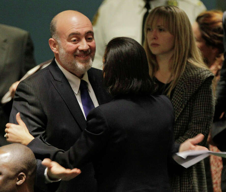 Israel's Foreign Minister Avigdor Lieberman gestures as he embraces the United States Ambassador Susan Rice after speaking during a meeting of the United Nations General Assembly prior to a vote on a resolution on the issue of upgrading the Palestinian Authority's status to non-member observer state in the United Nations headquarters, Thursday, Nov. 29, 2012. (AP Photo/Kathy Willens) / AP
