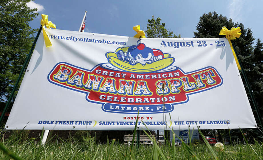 A banner at the entrance to town tells of the upcoming Banana Split Celebration in Latrobe, Pa., Wednesday Aug. 21, 2013. A weekend of festivities are planned to surround the dedication of a Pennsylvania Historical and Museum Commission marker to be dedicated Friday, Aug. 23 that acknowledges apprentice pharmacist David E. Strickler for inventing the banana split there in 1904. (AP Photo/Keith Srakocic) / AP