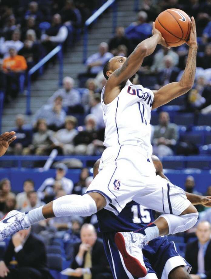 AP photoUConn's Ryan Boatright drives during Thursday's game against New Hampshire. UConn scored a 61-53 victory.