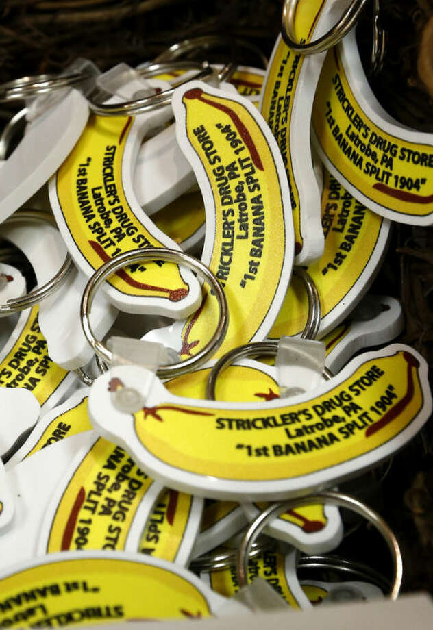 A basket full of keychains with fobs in the shape of a banana commemorating the banana split sundae are for sale at the Latrobe Art Center in Latrobe, Pa., Wednesday Aug. 21, 2013. A weekend of festivities are planned to surround the dedication of a Pennsylvania Historical and Museum Commission marker to be dedicated Friday, Aug. 23 that acknowledges apprentice pharmacist David E. Strickler for inventing the banana split there in 1904. (AP Photo/Keith Srakocic)