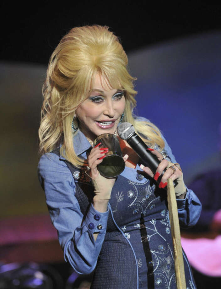 FILE - In this May 10, 2013 file photo, Dolly Parton appears at her Dollywood theme park in Pigeon Forge, Tenn. The park plans to open DreamMore Resort in 2015 as part of a planned $300 million expansion to take place over the next decade. The resort hotel has been Parton's dream ever since she affixed her name to the theme park 28 years ago. (AP Photo/The Knoxville News Sentinel, Paul Efird, File)