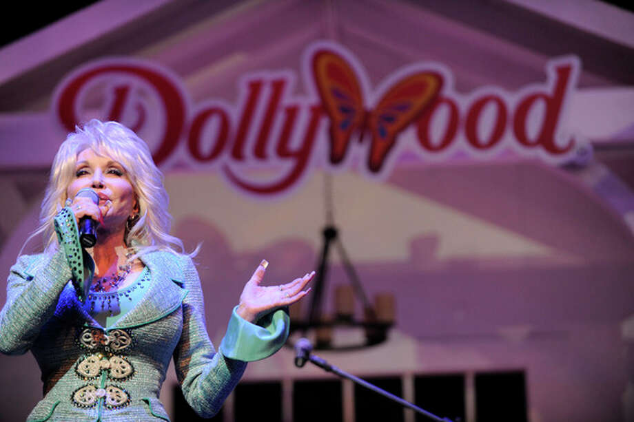 AP photoDolly Parton speaks during a news conference to annouce plans to expand her Dollywood properties this week in Pigeon Forge, Tenn. Parton said she is going invest $300 million over the next 10 years in a project that includes a 300-room resort and a dual-launch coaster currently under construction in Dollywood. / Knoxville News Sentinel