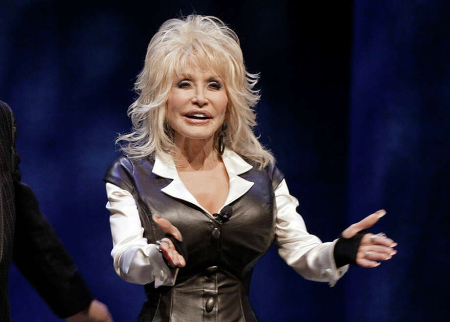 FILE - This Jan. 19, 2012 file photo shows entertainer Dolly Parton during a news conference in Nashville, Tenn., to announce plans for a water-snow park. Dollywood plans to open DreamMore Resort in 2015. It's part of a planned $300 million expansion to take place over the next decade. A new roller coaster, this one aimed at families, is scheduled to open in 2014. (AP Photo/Mark Humphrey, File) / AP