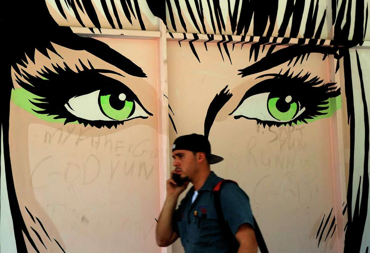 A public program is bringing murals and folksy paintings to part of Main Street.