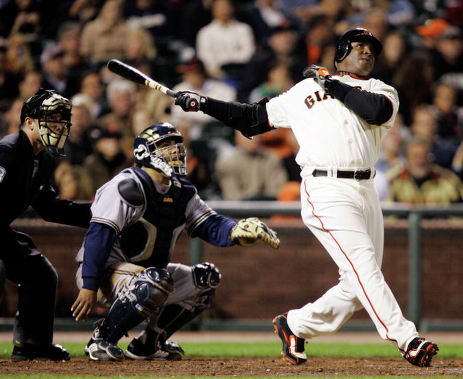 FILE - In this Aug. 24, 2007, file photo, San Francisco Giants' Barry Bonds, right, hits his 761st career home run, a solo effort, off Milwaukee Brewers pitcher Chris Capuano in the fourth inning of a baseball game in San Francisco. Bonds, Roger Clemens and Sammy Sosa are set to show up on the Hall of Fame ballot for the first time on Wednesday, Nov. 28, 2012, and fans will soon find out whether drug allegations block the former stars from reaching baseball's shrine. (AP Photo/Marcio Jose Sanchez, File) / AP