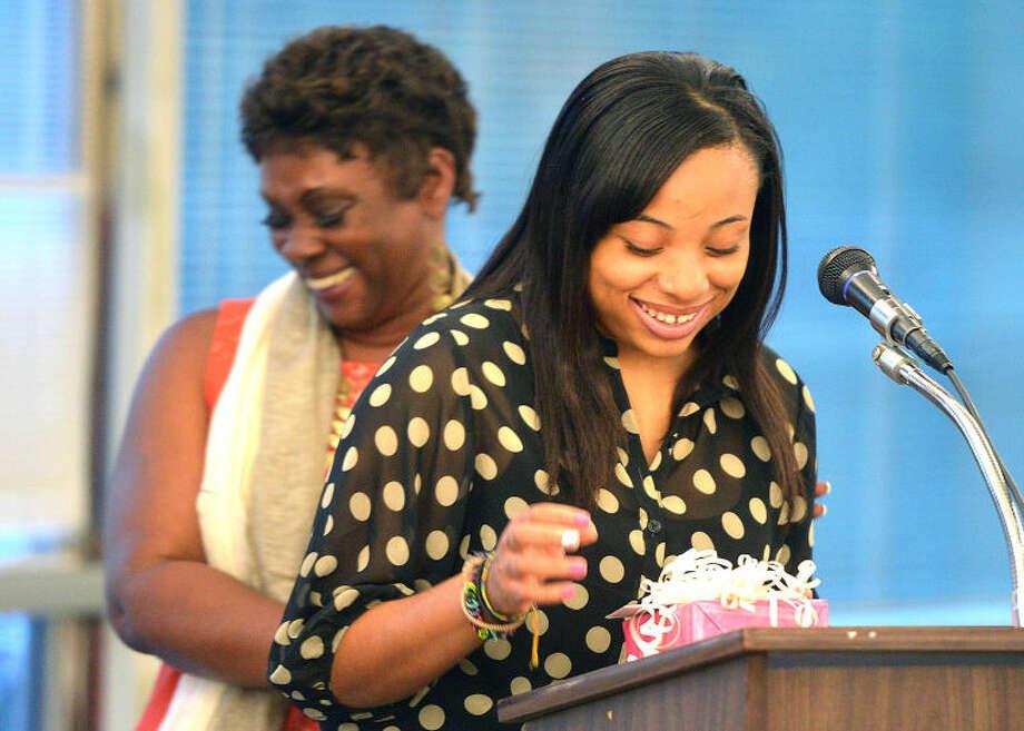 Hour Photo/Alex von Kleydorff Sophonie Cam accepts her scholarship from Stamford NAACP