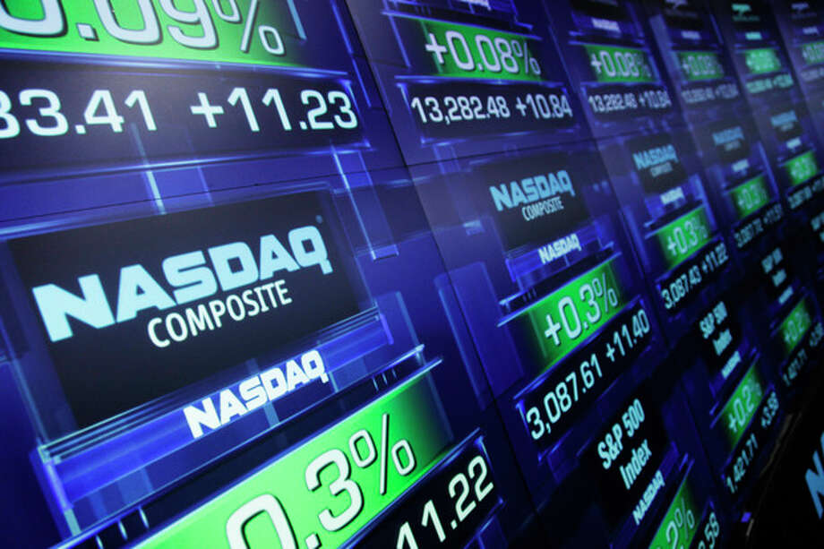 FILE - In this Tuesday, Aug. 21, 2012, file photo, stock prices are shown at the Nasdaq MarketSite, in New York. Trading was halted in Nasdaq-listed securities on Thursday, Aug. 22, 2013, because of a technical problem. The exchange sent out an alert to traders at 12:20 p.m. EDT saying that trading was being halted until further notice because of problems with a quote dissemination system. (AP Photo/Mark Lennihan, File) / AP
