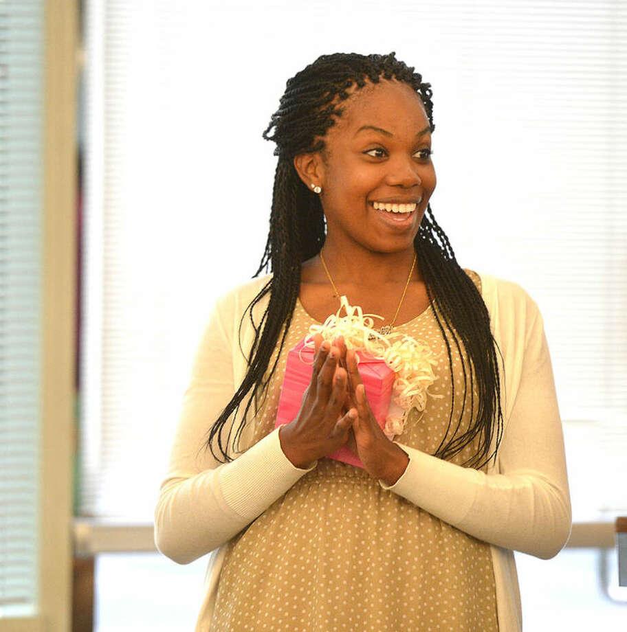 Hour Photo/Alex von Kleydorff Ashyla Cody accepts her scholarship from Stamford NAACP