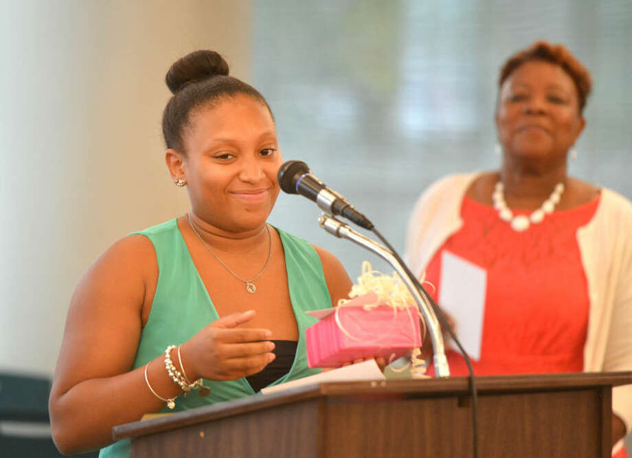 Hour Photo/Alex von Kleydorff Shalimar Azima accepts her scholarship from Stamford NAACP