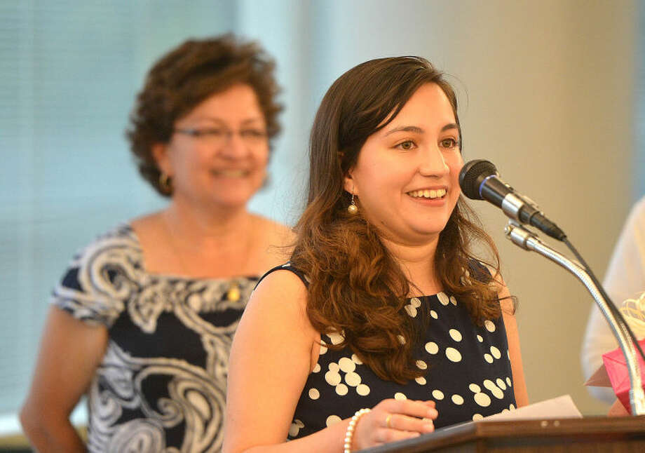 Hour Photo/Alex von Kleydorff Andrea Lopez Salazar accepts her scholarship from Stamford NAACP
