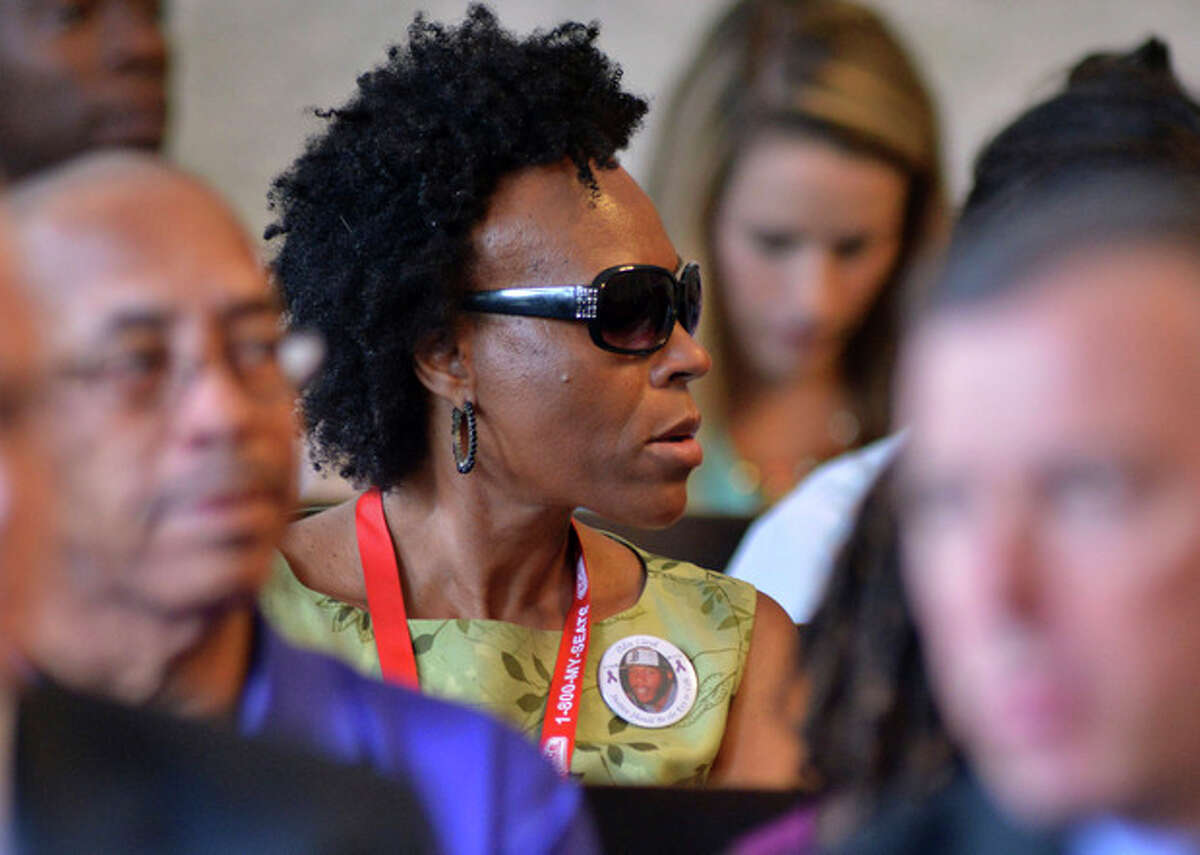 A women wearing a button with a picture of Odin Lloyd listens during court proceedings for former New England Patriot football player Aaron Hernandez, in Attleboro, Mass., Thursday, Aug. 22, 2013. Hernandez was indicted Thursday on first-degree murder and weapons charges in the death of a friend whose bullet-riddled body was found in an industrial park about a mile from the ex-player's home. The six-count grand jury indictment charges Hernandez with killing 27-year-old Lloyd, a semi-professional football player from Boston who was dating the sister of Hernandez's girlfriend. (AP Photo/Josh Reynolds)