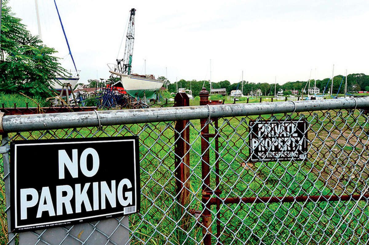 The boat yard at 71-76 Rowaton Ave will close and condominiums will be built on the lot. Hour photo / Erik Trautmann