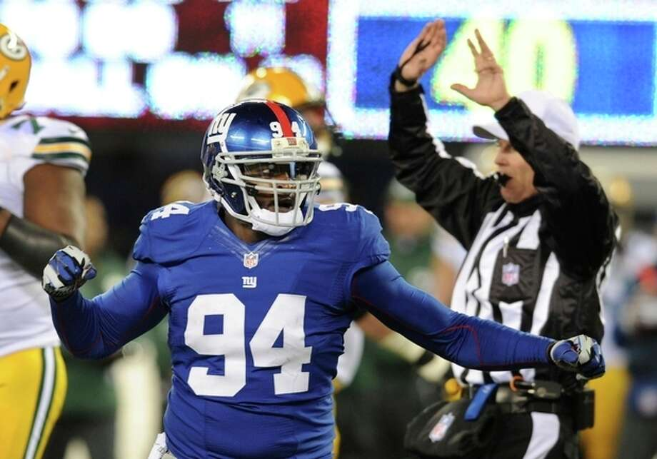 New York Giants linebacker Mathias Kiwanuka (94) celebrates a sack of Green Bay Packers' Aaron Rodgers during the second half of an NFL football game, Sunday, Nov. 25, 2012, in East Rutherford, N.J. (AP Photo/Bill Kostroun) / FR51951 AP