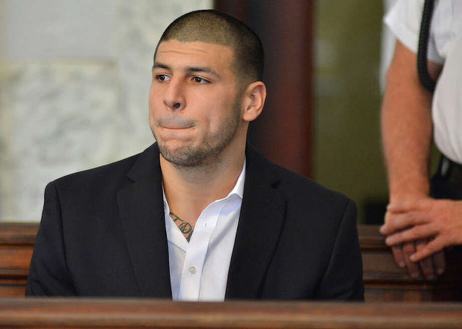 Former New England Patriot football player Aaron Hernandez, listens to procedings in a court in Attleboro, Mass., Thursday, Aug. 22, 2013. Hernandez was indicted on first-degree murder and weapons charges in the death of a friend whose bullet-riddled body was found in an industrial park about a mile from the ex-player's home. (AP Photo/Josh Reynolds) / FR25426 AP