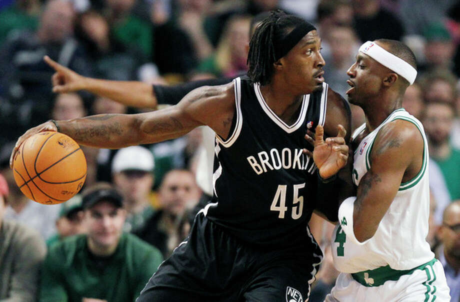 Brooklyn Nets' Gerald Wallace (45) looks to move against Boston Celtics' Jason Terry, right, in the first quarter of an NBA basketball game in Boston, Wednesday, Nov. 28, 2012. (AP Photo/Michael Dwyer) / AP