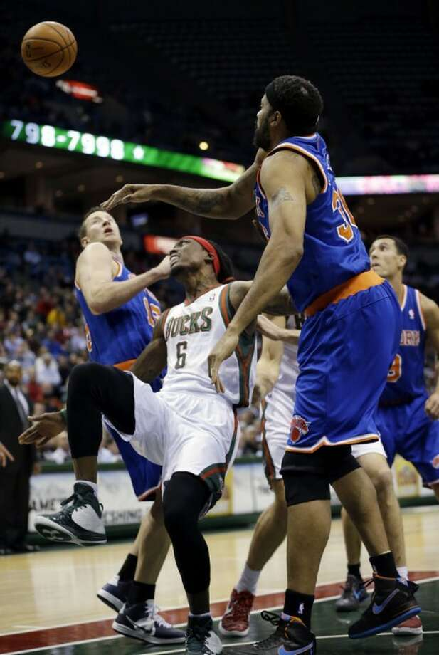 New York Knicks' Rasheed Wallace, right, blocks the shot of Milwaukee Bucks' Marquis Daniels (6) during the second half of an NBA basketball game Wednesday, Nov. 28, 2012, in Milwaukee. (AP Photo/Morry Gash)
