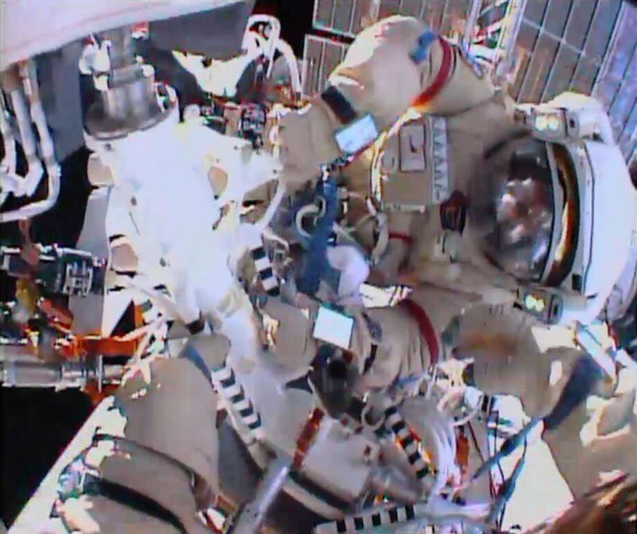 AP Photo/NASAIn this image from video made available by NASA, cosmonauts Fyodor Yurchikhin and Aleksandr Misurkin participate in a spacewalk outside the International Space Station on Thursday, Aug. 22. / NASA