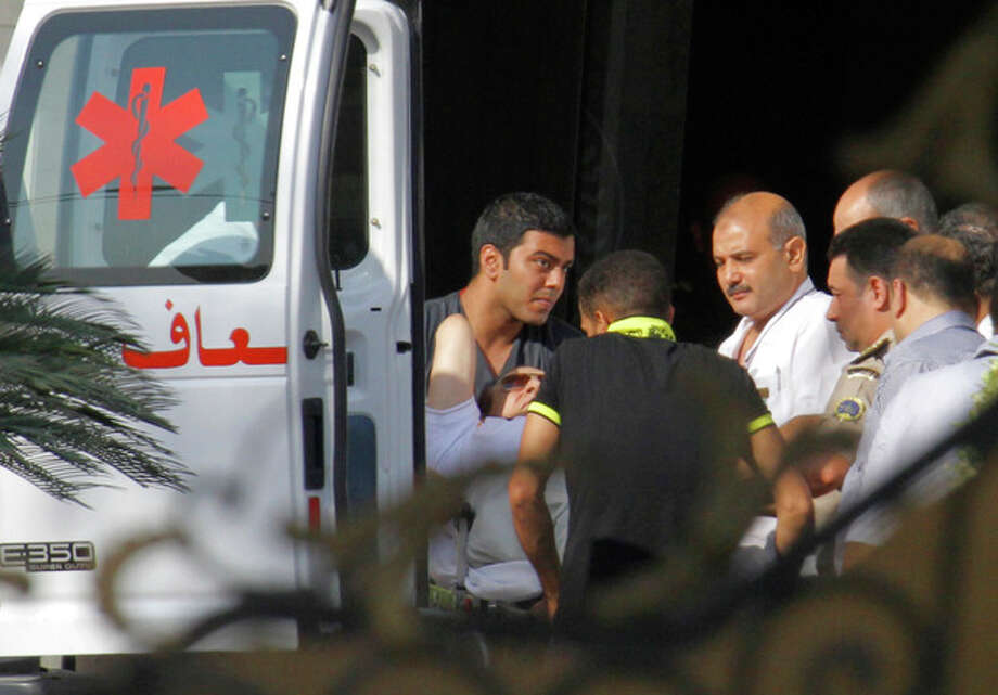 Medics escort former Egyptian President Hosni Mubarak, 85, into an ambulance after after he was flown by a helicopter ambulance to the Maadi Military Hospital from Tora prison in, Cairo, Thursday, Aug. 22, 2013. Mubarak has been released from jail and taken to military hospital in Cairo. (AP Photo/Amr Nabil) / AP