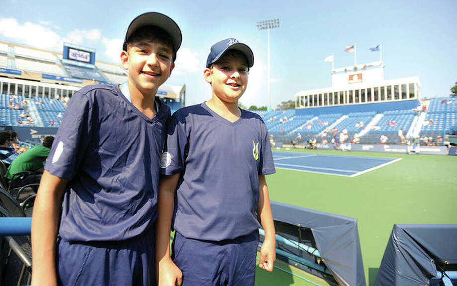 Hour photo/John Nash - Twin brothers Nathan, left, and David Katz are ball boys at this year's New Haven Open at Yale. The pair reside in Weston.