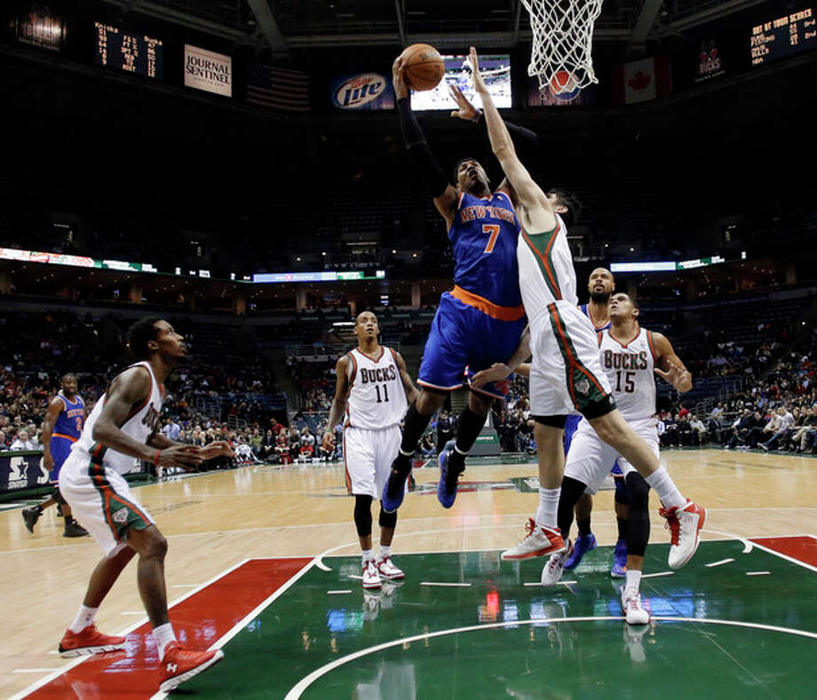 New York Knicks' Carmelo Anthony drives to the basket during the first half of an NBA basketball game against the Milwaukee Bucks on Wednesday, Nov. 28, 2012, in Milwaukee. (AP Photo/Morry Gash) / AP
