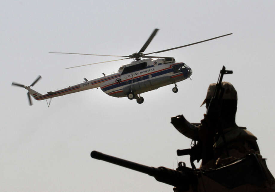An Egyptian soldier stands guard as a helicopter carrying former Egyptian President Hosni Mubarak, 85, lands at Maadi Military Hospital from Tora Prison in, Cairo, Egypt, Thursday, Aug. 22, 2013. Egypt's ousted leader Hosni Mubarak has been released from jail and taken to military hospital in Cairo. (AP Photo/Amr Nabil) / AP