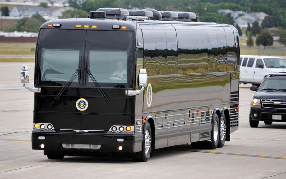 "FILE - In this Aug. 13, 2012, file photo, President Barack Obama's armored bus that will tour Iowa pulls up next to Air Force One, at Offutt Air Force Base in Bellevue, Neb. In 2011, the Secret Service purchased the $1.1 million bus for Obama's first bus tour as president. The impenetrable-looking black bus has dark tinted windows and flashing red and blue lights. Obama is launching a two-day bus tour on Thursday, Aug. 22, 2013, through New York and Pennsylvania to tout proposals for making college more affordable, a goal he has cast as ""a personal mission."" (AP Photo/Dave Weaver, File) / FR67562 AP"