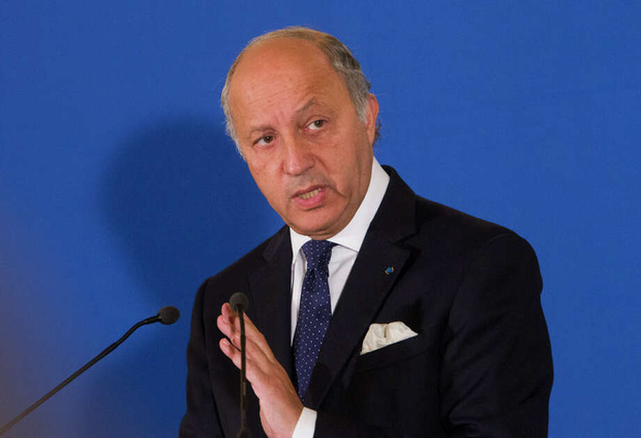 France's Foreign Minister Laurent Fabius speaks during a press meeting at the Quai d' Orsay, in Paris, Tuesday, Sept. 10, 2013. Fabuis said France will float a resolution in the U.N. Security Council aimed at forcing Syria to make public its chemical weapons program, place it under international control and dismantle it. (AP Photo/Jacques Brinon) / AP