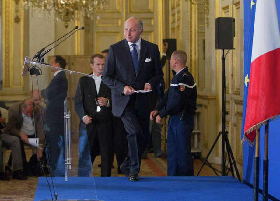 France's Foreign Minister Laurent Fabius arrives at the press meeting in the Quai d' Orsay, in Paris Tuesday, Sept. 10, 2013. Fabuis said France will float a resolution in the U.N. Security Council aimed at forcing Syria to make public its chemical weapons program, place it under international control and dismantle it. (AP Photo/Jacques Brinon) / AP