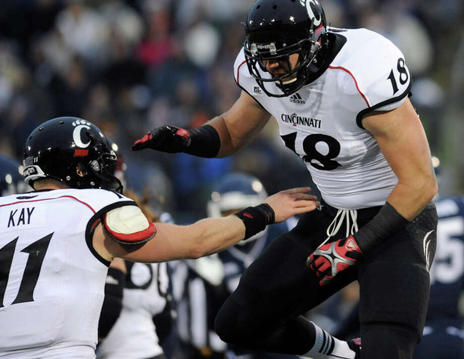 Cincinnati quarterback Brendon Kay, left, celebrates with Cincinnati tight end Travis Kelce, right, after Kelce's touchdown during the first half of an NCAA college football game at Rentschler Field in East Hartford, Conn., Saturday, Dec. 1, 2012. (AP Photo/Jessica Hill) / FR125654 AP