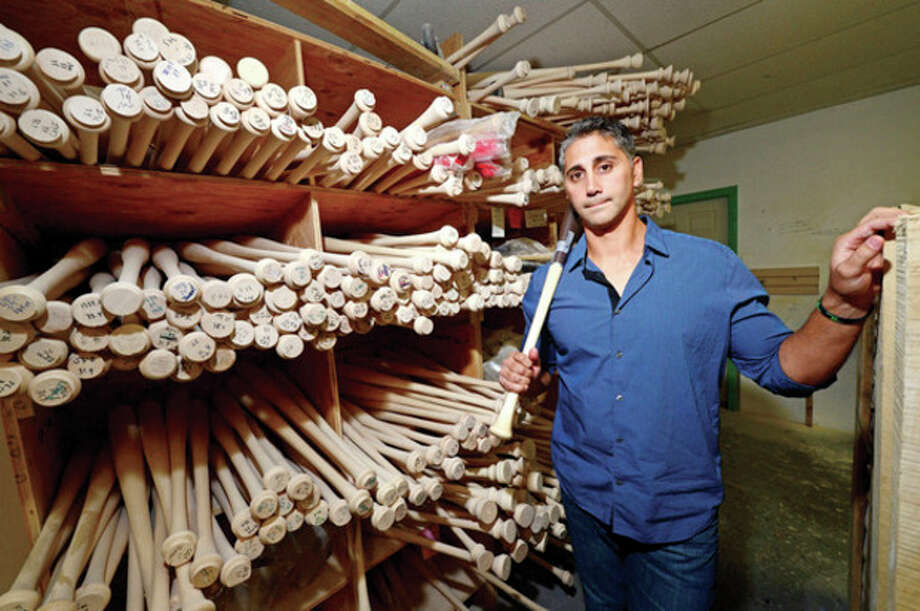 Hour photo / Erik TrautmannPete Tucci Jr., former standout baseball player at Norwalk High School, has started his own business making wood bats, Tucci Lumber Company. / (C)2013, The Hour Newspapers, all rights reserved