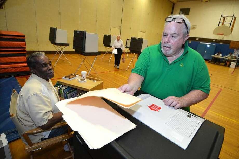 Hour Photo/Alex von Kleydorff . Chris Cavanagh casts his vote at Marvin Elementary school on Tuesday