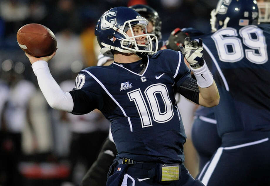 Connecticut quarterback Chandler Whitmer (10) throws during the first half of an NCAA college football game against Cincinnati at Rentschler Field in East Hartford, Conn., Saturday, Dec. 1, 2012. (AP Photo/Jessica Hill) / FR125654 AP