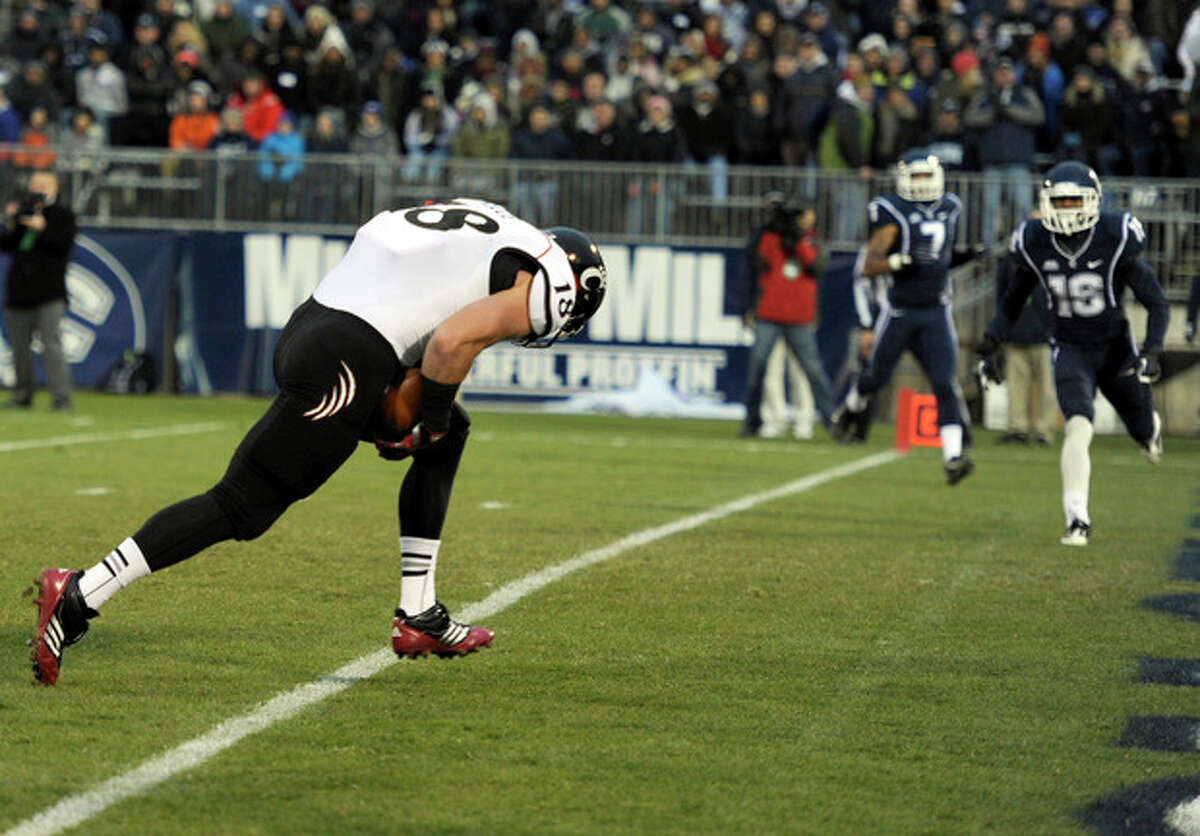 Cincinnati tight end Travis Kelce, left, crosses the goal line for a touchdown during the first half of an NCAA college football game against Connecticut at Rentschler Field in East Hartford, Conn., Saturday, Dec. 1, 2012. (AP Photo/Jessica Hill)