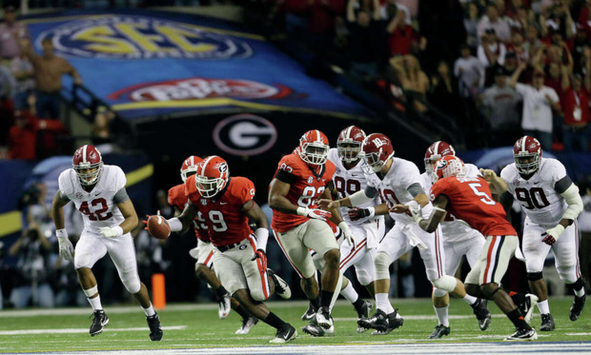 Georgia linebacker Alec Ogletree (9) reaches for a blocked field goal before returning it for a touchdown during the second half of the Southeastern Conference championship NCAA college footballgame against Alabama, Saturday, Dec. 1, 2012, in Atlanta. (AP Photo/David Goldman)