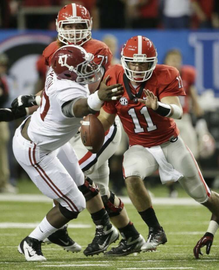 Alabama linebacker Xzavier Dickson (47) tackles Georgia quarterback Aaron Murray (11) during the first half of the Southeastern Conference championship NCAA college football game, Saturday, Dec. 1, 2012, in Atlanta. (AP Photo/Dave Martin)