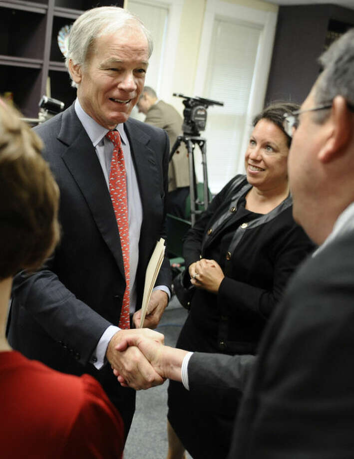 Republican Tom Foley shakes hands with supporters after a news conference to announce a committee to explore his prospects for the 2014 Connecticut governor's race in Bridgeport, Conn., Tuesday, Sept. 10, 2013. Foley said Tuesday that he is weighing another run for Connecticut governor, attacking the record of the Democrat who defeated him in 2010. (AP Photo/Jessica Hill)