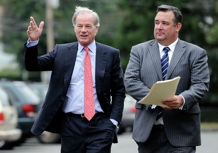 Republican Tom Foley, left, walks with former campaign chairman Justin Clark, right, to a news conference to announce a committee to explore his prospects for the 2014 Connecticut governor's race in Bridgeport, Conn., Tuesday, Sept. 10, 2013. Foley said Tuesday that he is weighing another run for Connecticut governor, attacking the record of Gov. Dannel P. Malloy, the Democrat who defeated him in 2010. (AP Photo/Jessica Hill) / FR125654 AP