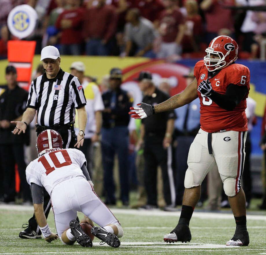 Georgia defensive lineman John Jenkins reacts to sacking Alabama quarterback AJ McCarron (10) during the first half of the Southeastern Conference championship NCAA college football†game, Saturday, Dec. 1, 2012, in Atlanta. (AP Photo/David Goldman) / AP
